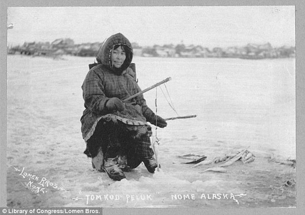 Inuit woman ice fishing early 20th century